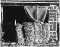 Straw bales provide good shelter for lambing pens and can be burned after lambing - The Veterinary Book for Sheep Farmers